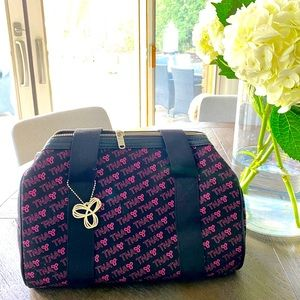 TNA small duffel bag with pink writing